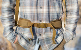 A Coyote brown Padded Hip Belt attached to a Guide's Edition Synapse 25 being worn, as shown from the front.
