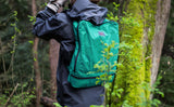 A person hiking with the Aeronaut 45 Packing Cube Backpack.