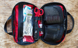 Interior shot of a filled First Aid Pouch in Red