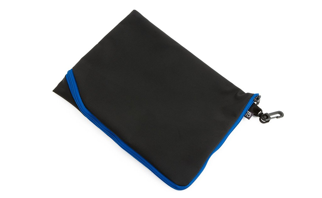 An A5 Ghost Whale Pouch made with black material and an Island (blue) zipper.