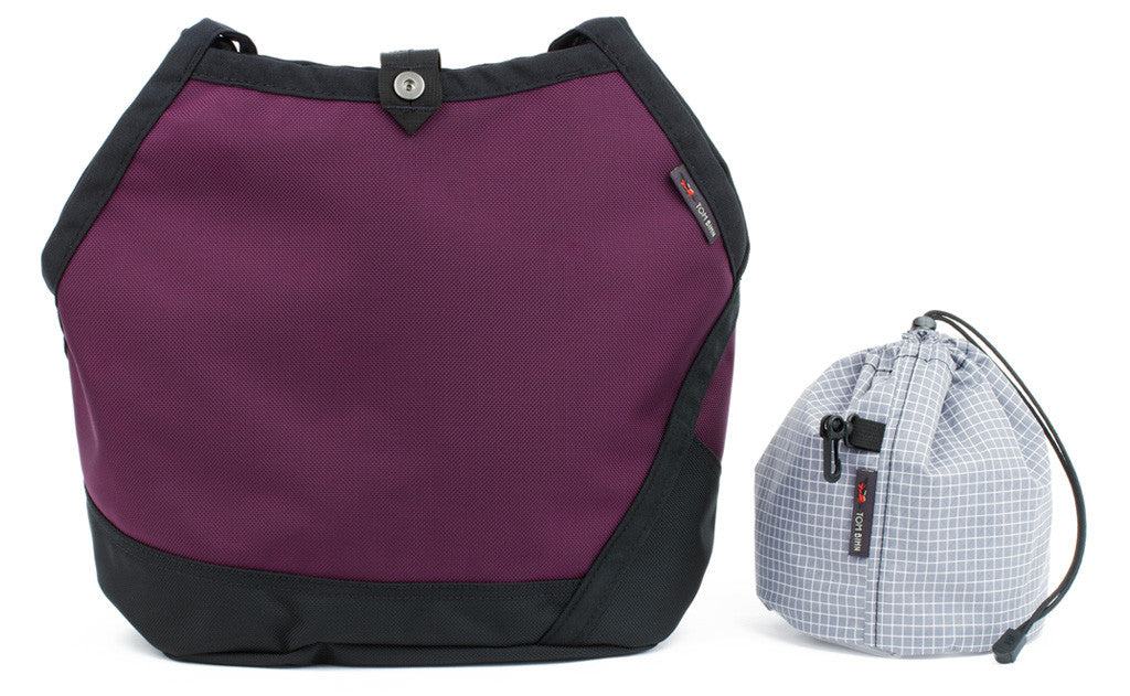 A Swift in Aubergine (dark purple) 1050 Ballistic with Northwest Sky (light grey with white grid) 200 Halcyon interior and Yarn Stuff Sack.