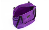 An above shot of the Pop Tote in Alphaviolet (bright purple) 525 Ballistic with the main compartment open.