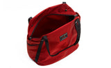 An above shot of the Pop Tote in Mars Red 525 Ballistic with the main compartment open.