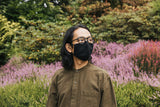Man wearing the V2 Mask in 100% Cotton Flannel while standing in a garden.