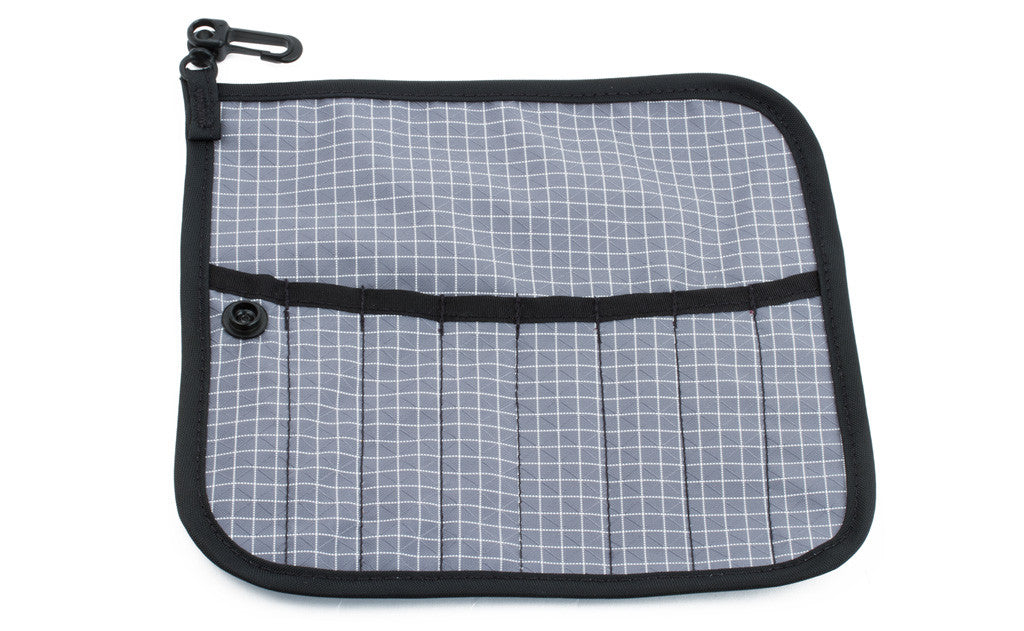 The front of a Tool Pen Wrap in Northwest Sky (light grey with white grid) 200 Halcyon.