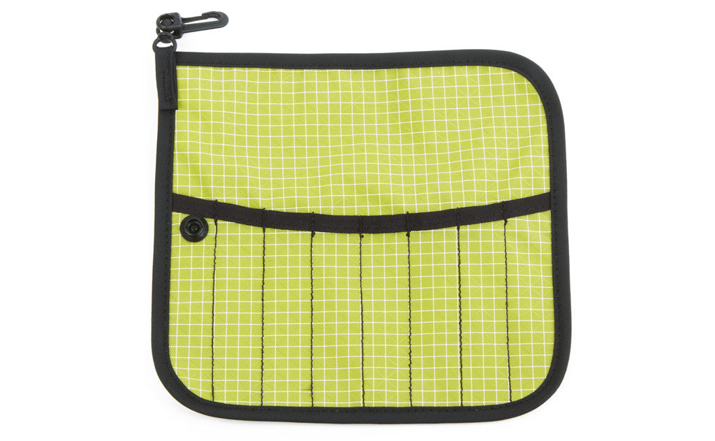 The front of a Tool Pen Wrap in Wasabi (green with white grid) 200 Halcyon.