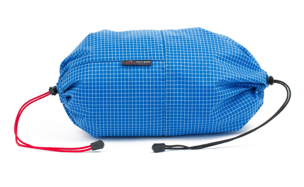 An Aeronaut 45 Travel Laundry Stuff Sack in Island (blue with white grid) 200 Halcyon.