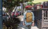 A person wearing the Tri-Star Packing Cube Backpack.