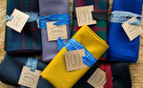 Various colors of the Shepherd's Wool Utility Cloth folded and tied.