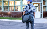 A person wearing an Aeronaut 30 as a shoulder bag using the optional Absolute Strap.