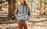 Person wearing the Design Lab Edition Packing Cube Shoulder Bag in Northwest Sky while standing in a forest.