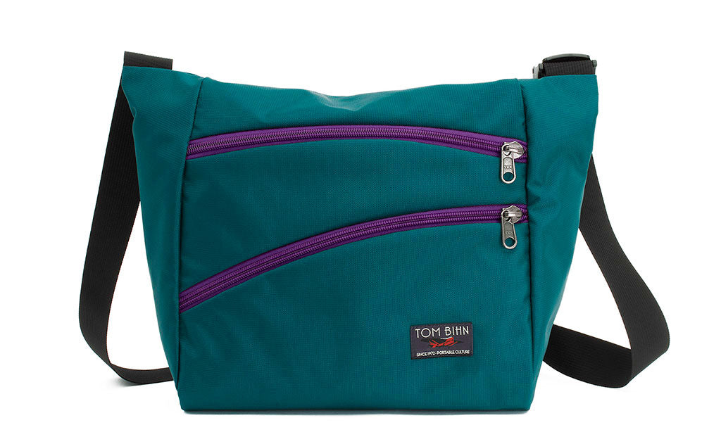 Icon in Seapine (bluish green) 630 Recycled with Ultraviolet (purple) zippers.