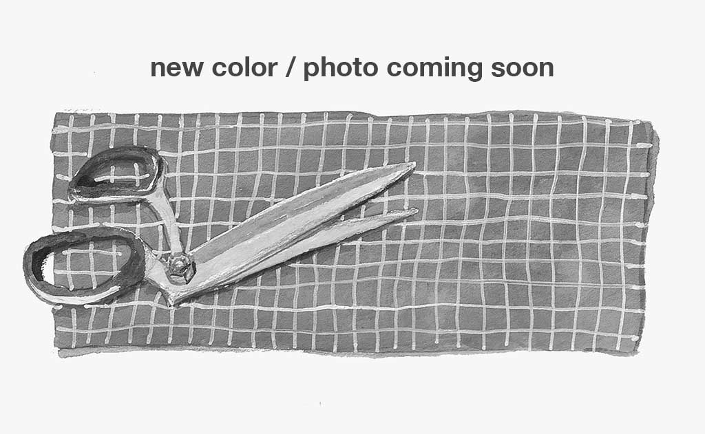 Text: new color / photo coming soon; Image: An illustration of shears on a length of fabric.