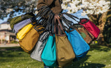 So many colors of Shop Bags! Left to right: Olive, Dawn, Canary, Coyote, Cloud, Mayura, Olive Twill, Island, Beaver, Red Blend.