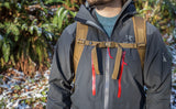 A person wearing the Guide's Edition Synik 30 with the sternum strap buckled.