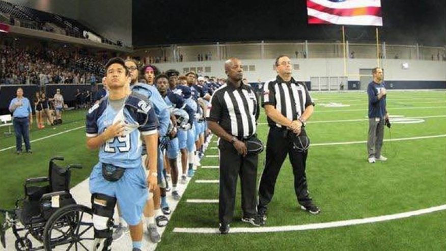 Injured Teen Football Player Stands For National Anthem