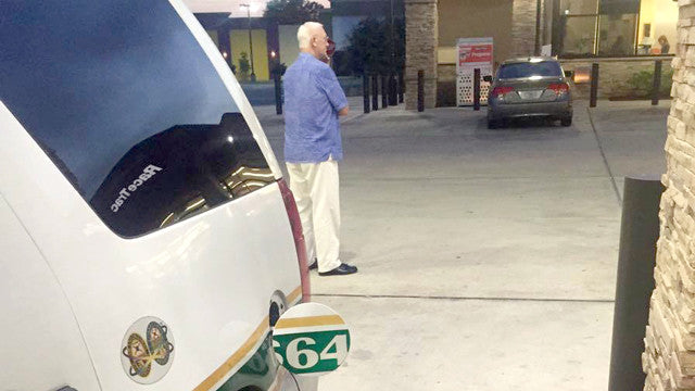 Army Veteran Stands Guard As Police Officer Pumps Gas