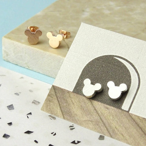 Mouse ears earrings on an illustrated background