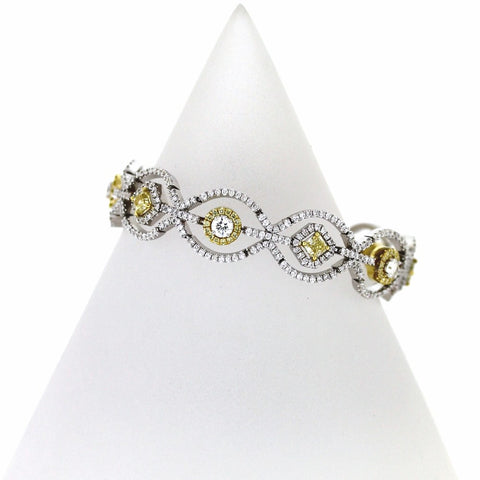 Round Brilliant Diamonds = 3.49 Fancy Yellow Radiant Cut Diamonds = 1.78 Fancy Yellow Round Brilliant Diamonds = 1.19 34.1gr 18K Yellow Gold Bracelet BR2129