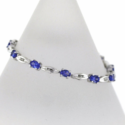 Estate 11 Tanzanite = 6.00cts 44 Baguette = .60cts 13.9gr 7.25