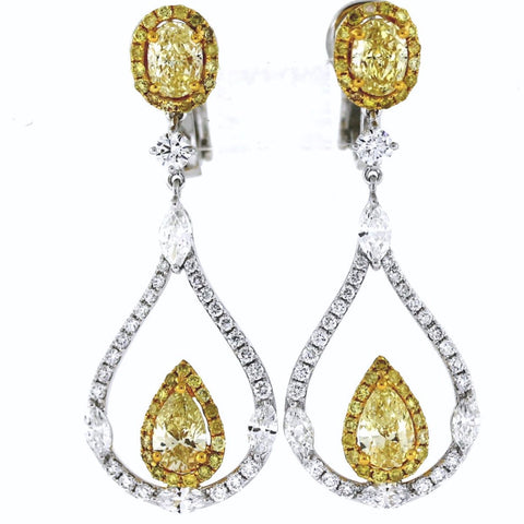 Pear Shape = 1.04 Fancy Yellow SI1 2 Oval 1.33 Fancy Yellow Light VVS 66 Round Brilliant = 0.558 Marquise = .8050 Round Brilliant = .71 7.91gr Two Tone 18K Gold Earrings ER3178