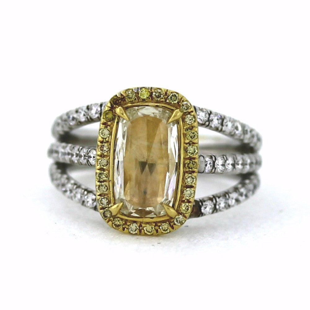 78 Round Brilliant = .84 27 Fancy Yellow = .15 1 Radiant Cut = 1.09ct Fancy Yellow 7.4gr Two Tone 18K Gold Lady's Ring LR1593