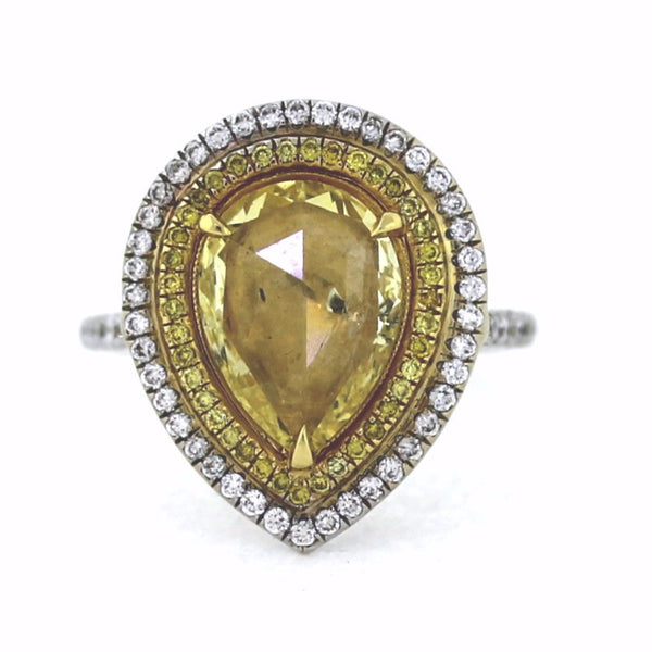 58 Round Brilliant = .44 39 Fancy Yellow = .14 1 Pear Shape Radiant Cut = 1.82 Fancy Yellow 8.2gr Two Tone 18K Gold Lady's Ring LR1595