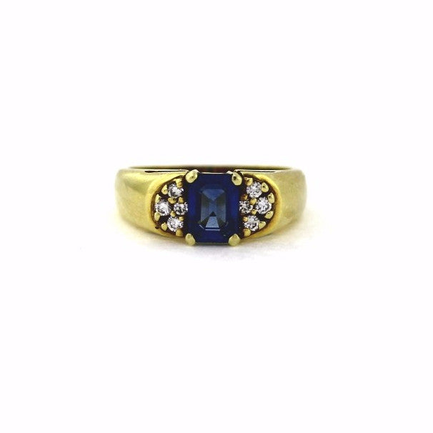 Estate 1 Emerald Cut Sapphire = 1.32 8 Round Brilliant = .16 5.6gr 14K Yellow Gold Lady's Ring LR2160