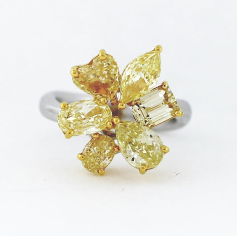 1 Fancy Yellow SI2 Oval Diamond = 0.51ct  Diamonds and 6 Fancy Yellow Diamonds  = 4.95ctw ALL GIA  Two Tone 18K Gold Ring LR2589