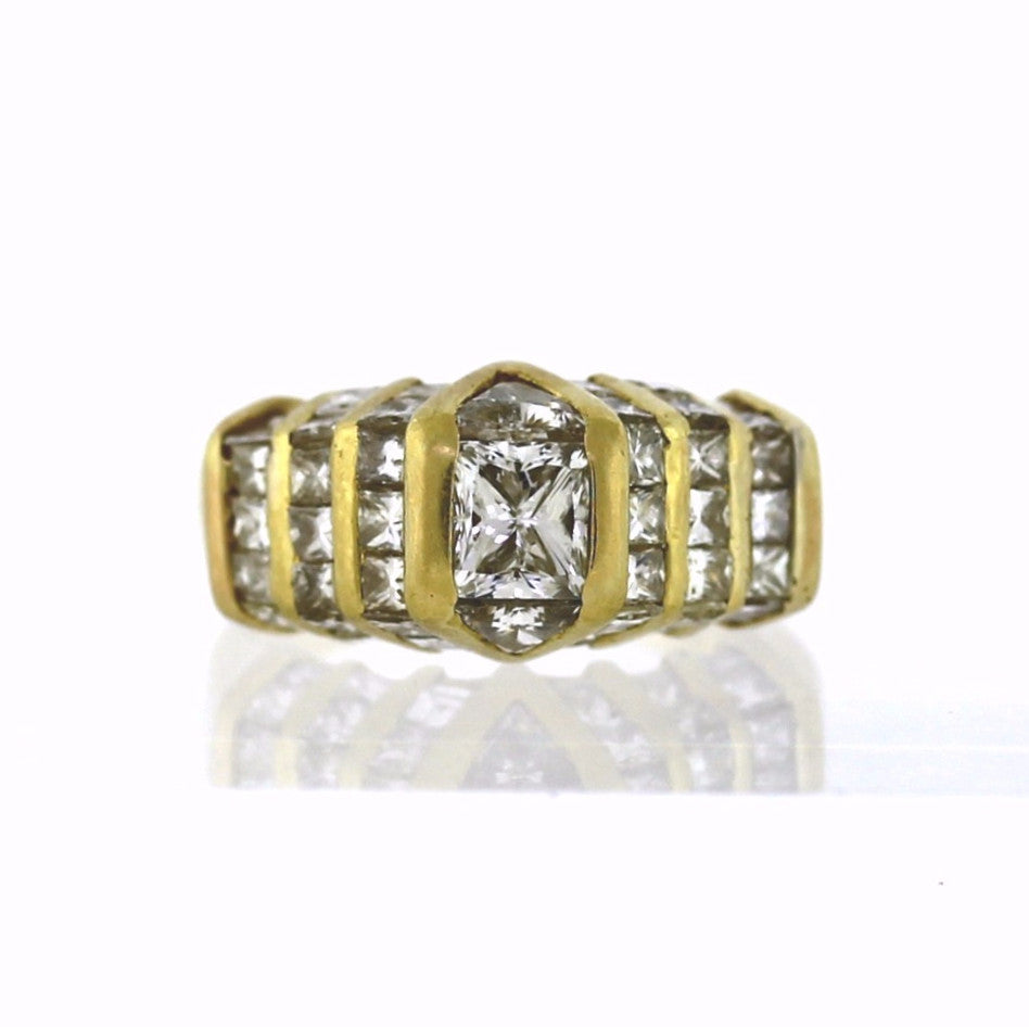 Estate 1 Princess Cut = 1.00 2 Trillion Cut = .45 17 Princess Cut = 1.20 11.9gr 18K Yellow Gold Lady's Ring LR2706