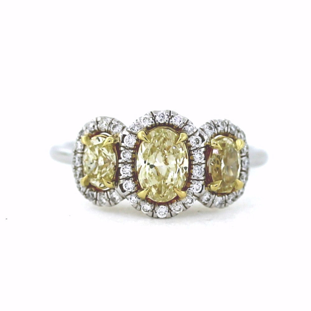1 Oval = 0.59ct Fancy Yellow Light 1 Oval = 0.56ct Fancy Yellow 40 Round Brilliant = 0.21 Two Tone 18K Gold Lady's Ring LR2777