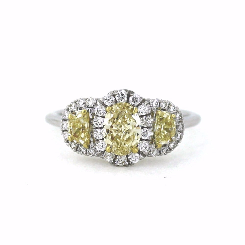 1 Oval = 0.71ct Fancy Yellow Light 2 Half Moon = 0.43c 32 Round Brilliant = 0.32ct Two Tone 18K Gold Lady's Ring LR2780