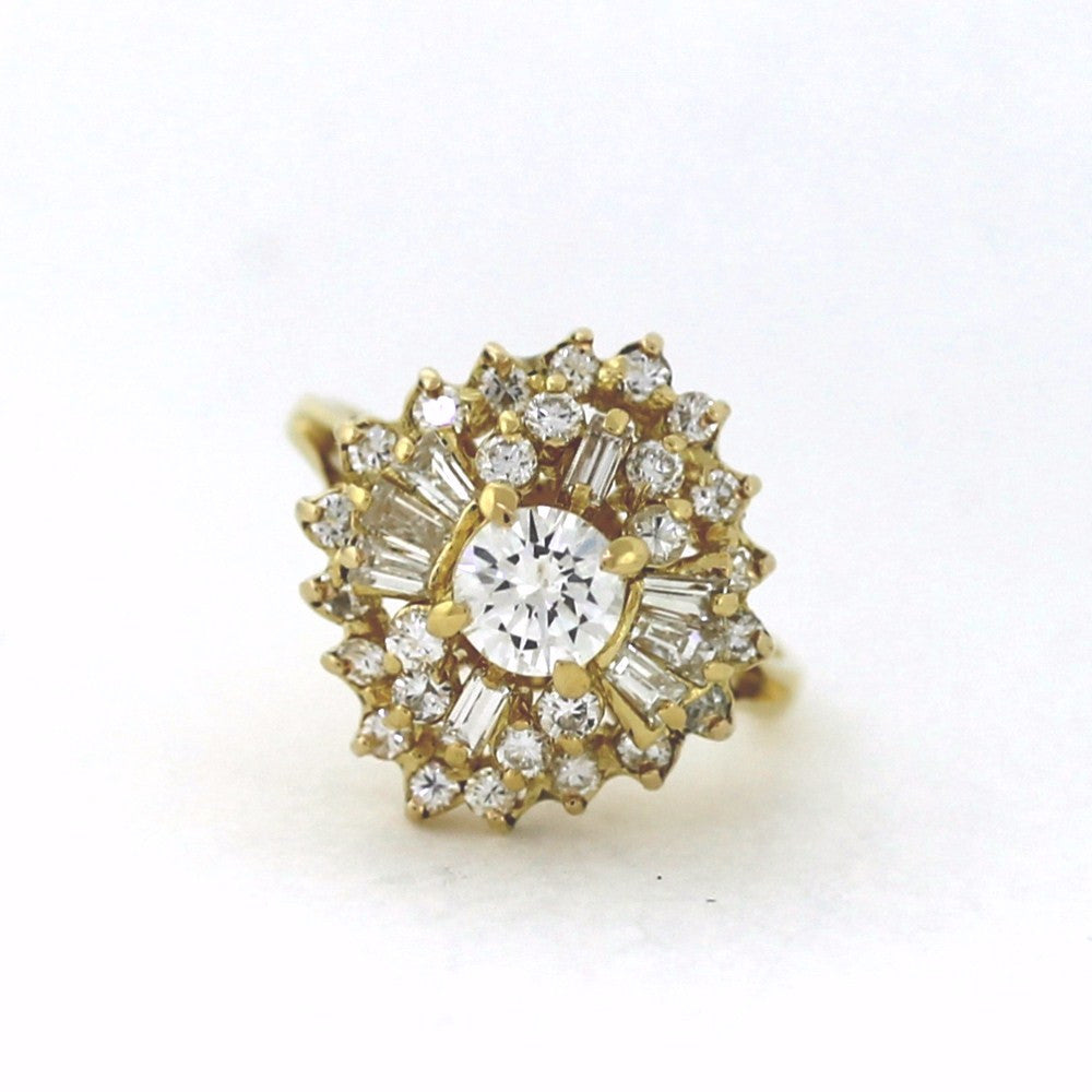 Estate 1 Round Brilliant = .50 26 Round Brilliant & 8 Baguette = 1.00ctw 5.17gr Weights Approx. 18K Yellow Gold Lady's Ring LR3098