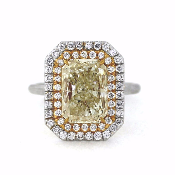 58 Round Brilliant = 0.60ct G VS1 1 Radiant Cut = 4.02ct Fancy Yellow Light SI2 Two Tone 18K Gold Lady's Ring LR3160