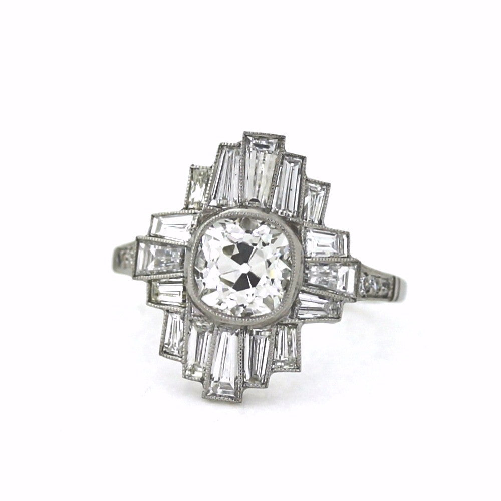 1 Cushion Cut = 1.84ct 16 Straight Baguette = 1.50ct 6 European Cut = .09 Platinum Lady's Ring LR3164