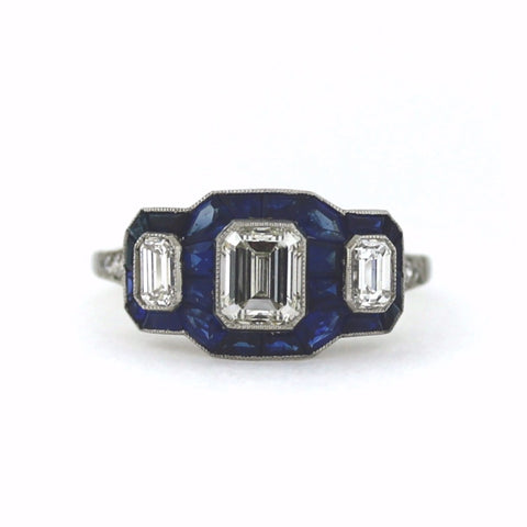 1 Emerald Cut Diamond = 0.88ct 2 Emerald Cut Diamonds = 0.48ct 6 European Cut Diamonds = .10 Sapphire = 2.30 3.82gr, Platinum Ring LR3372
