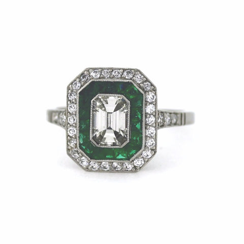 1 Emerald Cut Diamond = 0.75ct 33 European Cut Diamonds = .50ctw Emerald = 1.00ctw 4.06gr, Platinum Ring LR3376