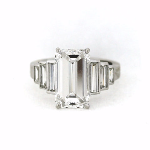 5.02 E VS2 Emerald Cut Diamond GIA = 11219787, 6 Baguette Diamonds = 1.01 ctw,  9.39gr, Platinum Lady's Ring LR3457, D17351