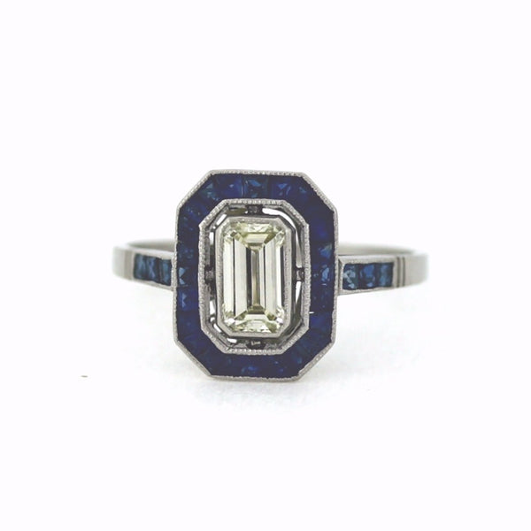 1 Emerald Cut Diamond = 0.64ct Fancy Yellow and Sapphire Accents 3.07gr, Platinum Ring LR3474