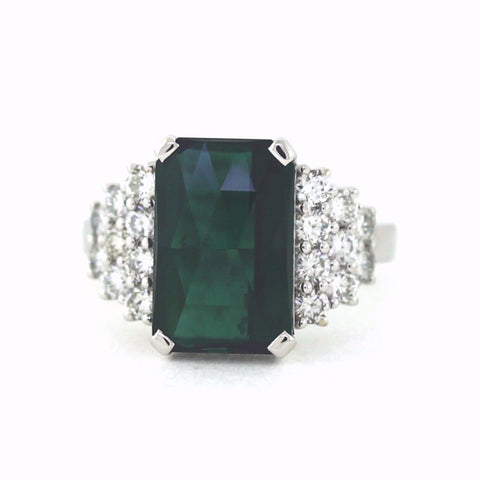 7.62ct Green Tourmaline , 10 Round Brilliant Diamonds = .579ct, 6 Round Brilliant Diamonds = 0.35ct H SI1, 2 Round Brilliant Diamonds = 0.11ct H SI3, 18K White Gold Ring LR3494