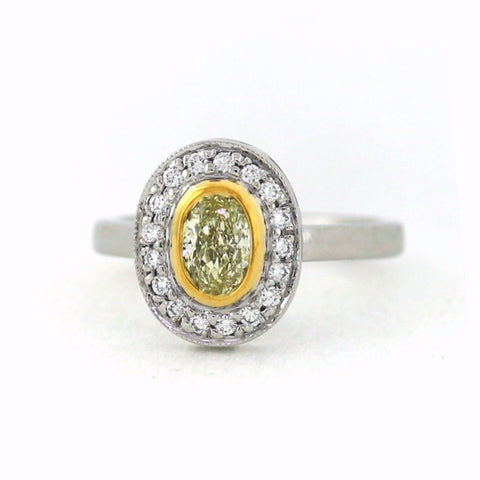.66 ct Fancy Yellow Oval Diamond, 18 Round Brilliant Diamonds = .50ctw, 5.99gr, Platinum and 18K Gold Ring LR3583