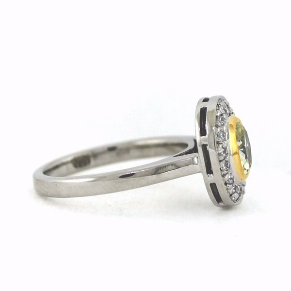 .66 ct Fancy Yellow Oval Diamond, 18 Round Brilliant Diamonds = .50ctw, 5.99gr, Platinum and 18K Gold Ring LR3584