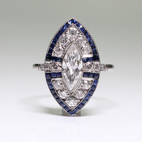 .75ct Marquise Cut Diamond, European Cut Diamonds = .59ctw, Sapphire Accents = .84ctw 4.2gr, Platinum Lady's Ring LR3663