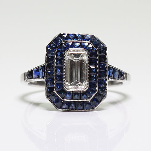 1 Emerald Cut Diamond  = 0.73ct and Sapphire = 1.50ctw  4.5gr Platinum Ring LR3803