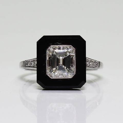 1 Emerald Cut Diamond  = 1.32ct and 6 Round Diamonds  = .08ctw  Onyx 4.9gr Platinum Ring LR3810