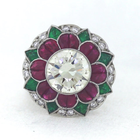 Estate 1 European Cut Diamond  = 3.50ct K/LVS  Rubies  = 2.25ctw  Round Diamonds  = .25ctw Emeralds = 1.00ct 8.6gr Platinum Ring LR3826