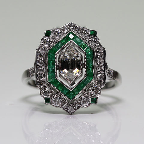 1 Marquise Cut Diamond  = .50ct  and Round Diamonds  = .50ctw Emerald = .50ctw  All weights Approx. 5.2gr Platinum Ring LR3883