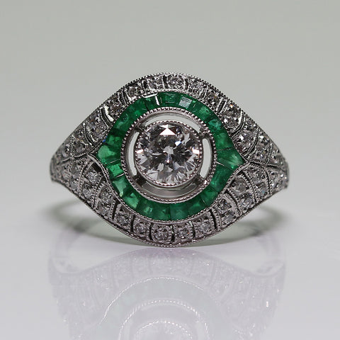 1 European Cut Diamond  = 0.40ct  Round Diamonds  = .50ctw Emeralds = .60ctw  All Weights Approx. 4.5gr Platinum Ring LR3884