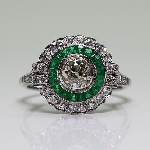 1 European Cut Diamond  = .55  and Round Diamonds  = .70ctw Emerald = .70ctw  4.5gr Platinum Ring LR3891
