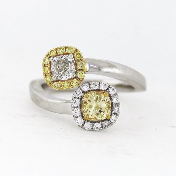 1 Cushion Cut G SI1 Diamond = .50ct with 1 Cushion Cut Facny Yellow Diamond = .66ct and 12 Round Brilliant Fancy Yellow Diamonds = .15ctw 14 Round Brilliant White Diamonds = .18ctw 6 .04gr Two Tone 18K Gold Ring LR3959